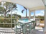 Enjoy a drink at the dinging table on the lanai in Pias Paradise Bonita Springs, a vacation rental
