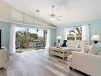 Living room with view to lanai at Pias Paradise just 1 mile from the Beach in Bonita Springs