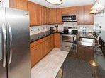 Kitchen with tile floors and backsplash