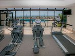 Cardio equipment overlooking the pool area
