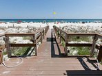 Boardwalk with outdoor shower leading to beach and Gulf
