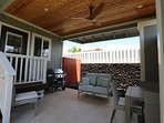 Covered lanai sitting area with a designer ceiling fan.