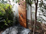 Hot water outdoor shower for beach day cleanup or rinsing off after time in the hot tub