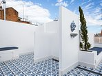 communal rooftop with solarium + exterior showers