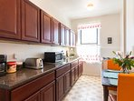 Nice large kitchen w all amenities.  You can cook, or order in & eat in. Pots Pans, Coffee Microwave