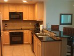 Kitchen offers granite and lots of counter & cabinet space. All small appliances, breakfast bar