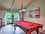 Get your competitive juices flowing on the pool table.