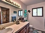 Rinse off the day in this large bathroom.