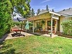 The backyard boasts a gas grill and cozy hammock.