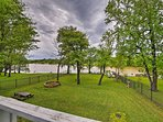 The property features a private fenced backyard and lake views!