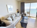 Living room with a queen sleeper sofa and private balcony access!