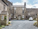 Period comfort with allocated car parking, in a peaceful courtyard just off Grassington main square