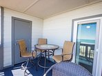 Enjoy this great oceanfront view from comfortable balcony furniture.