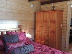 Queen log beds in both bedrooms