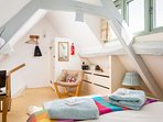 A stylish and characterful room, with a double bed