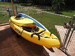 Kayaks and paddleboard for guest use.