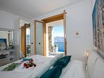Bedroom 1 double bed with access to the terrace and view of the lake
