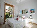 Bedroom 2 double bed with direct access to the private garden plus lake view