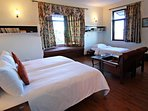 The third bedroom on the first floor has a small single bed along with the double-size bed