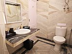 An attached bathroom with the ground floor bathroom comes with all amenities