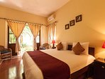 Bedroom on the ground level of the villa with a tiny private balcony to garden and attached bathroom
