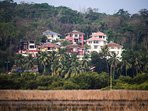 Tropical Woods Villas, a complex of luxury villas located in Britona with views of the Mapusa river