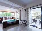 Master bedroom on ground floor with attached balcony. Views of the tropical forest