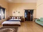 Master bed on the first floor is a large naturally lit room with private balcony over the garden