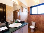 Bathroom attached to the bedroom four on ground floor with shower and free amenities