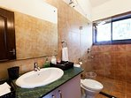 Bathroom attached to the master bedroom on first floor, with shower and free amenities