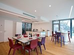 Open plan living room dining kitchen area with amazing view of the lake