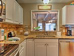 The kitchen is outfitted with granite countertops.