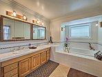 Take a soothing soak in the en-suite master bathroom.