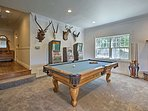 The game room offers ample entertainment including a pool table.
