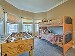 Kids will love this bedroom with a twin-over-twin bunk bed and foosball table.