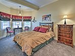 This spacious room boasts a soft queen bed.