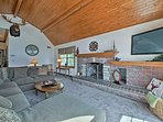 Watch the flat-screen TV while you sit fireside on the large sectional sofa.