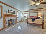 Turn on the gas fireplace before laying back on the queen bed.