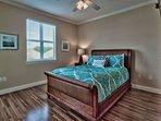 3rd Floor - Queen Bedroom w/ TV and Balcony Access