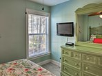 Each of the 5 bedrooms are equipped with flat-screen cable TVs.