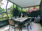 The screened lanai is a perfect spot for a meal or a game of Monopoly from the game cabinet