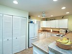 A full-equipped kitchen with a laundry closet, too!