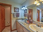 His-and-hers sinks make it easy to get ready with someone in this bathroom.