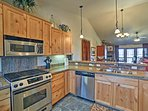 The space features stainless steel appliances and granite countertops.