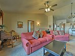 The living room offers comfortable seating accommodations.