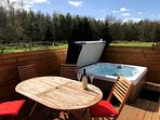Private hot tub and decking area in a scenic and tranquil setting.