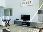 Open plan living includes TV, docking station and free Wifi