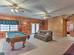 The game room has access to the outside deck.