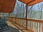 The porch overlooks the treeline.
