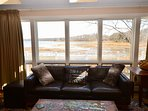 Main level living room with expansive views of the water